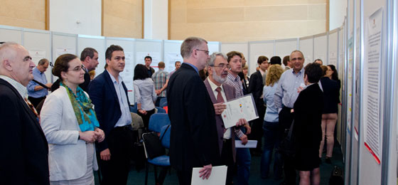 Researchers engaged in conversation at a poster presentation in the Romanian National Library in Bucharest. © UEFISCDI